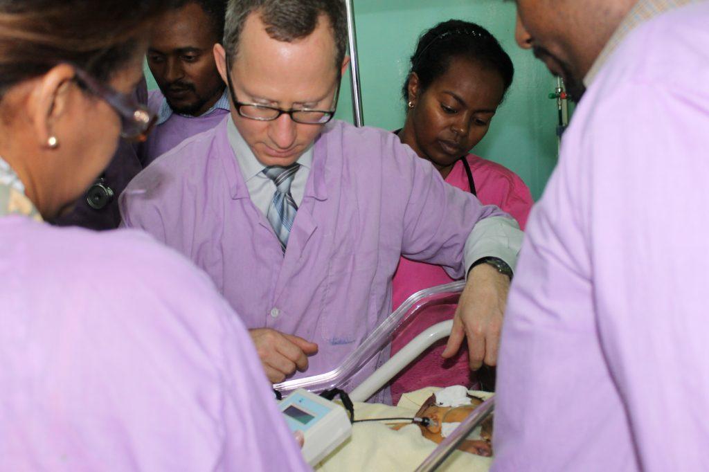 Jerald Altman, MD working with Sophia Mengistu, MD and her NICU team.
