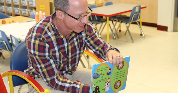 Dr. Jerald Altman reading Don't Stick Sticks Up Your Nose! Don't Stuff Stuff In Your Ears! to 3-year-old kids